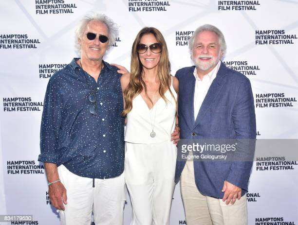 Eric Fischl Cristina Cuomo and Randy Mastro attend the The Hamptons International Film Festival SummerDocs Series Screening of WHITNEY CAN I BE ME at...