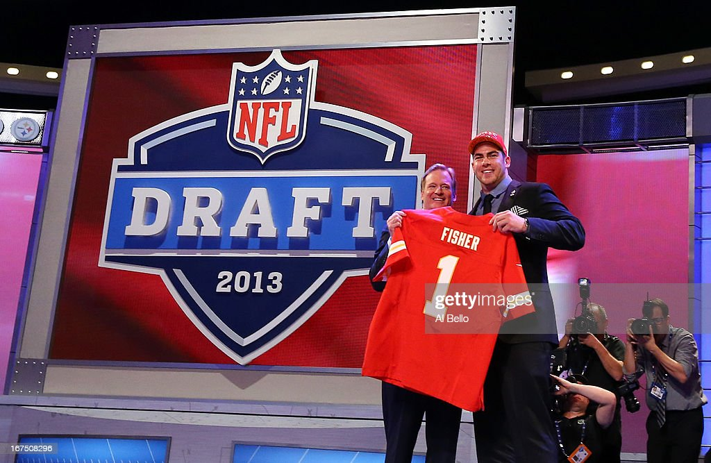 Eric Fisher (R) of Central Michigan Chippewas stands on stage with NFL COmmissioner Roger Goodell after Fisher was picked #1 overall by the Kansas City Chiefs in the first round of the 2013 NFL Draft at Radio City Music Hall on April 25, 2013 in New York City.