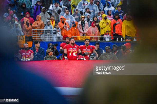 Eric Fisher of the Kansas City Chiefs and Taylor Lewan of the Tennessee Titans during the National Anthem before the 2019 NFL Pro Bowl at Camping...