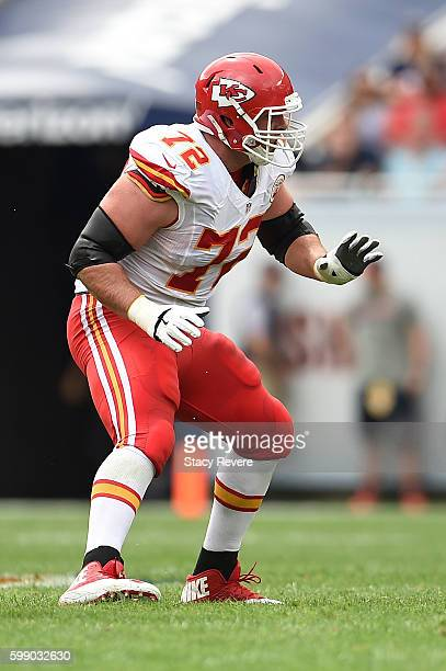 Eric Fisher of the Kansas City Chiefs anticipates a play during a game against the Chicago Bears at Soldier Field on August 27 2016 in Chicago...