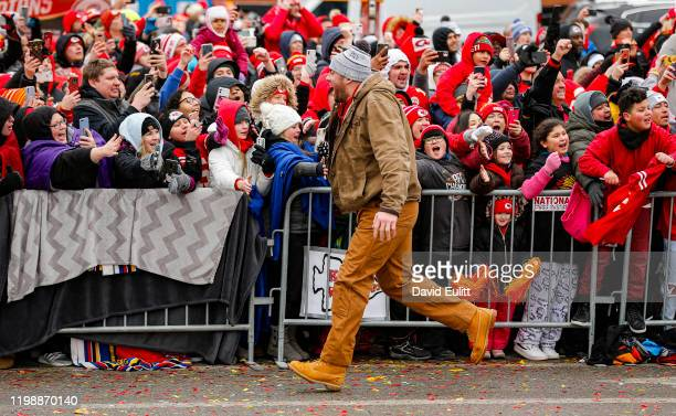 Eric Fisher of the Kansas City Chiefs greets the teams fans on February 5 2020 in Kansas City Missouri during the citys celebration parade for the...