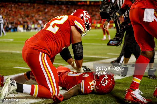 Eric Fisher of the Kansas City Chiefs pretends to provide CPR to teammate Tyreek Hill as a touchdown celebration in the fourth quarter of the game...