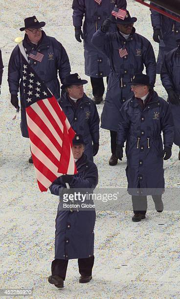 Eric Flaim carries the American Flag into Olympic Stadium ahead of the US Team for the 1998 Winter Olympics