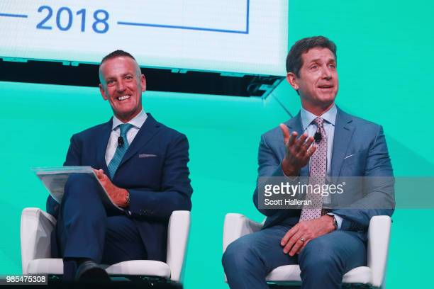 Eric Foss CEO of Aramark and Alex Gorsky CEO of Johnson Johnson speak on stage during the KPMG Women's Leadership Summit prior to the start of the...