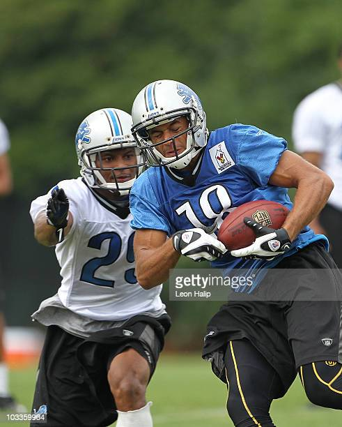 Eric Fowler and Eric King of the Detroit Lions go through the morning drills during training camp at the Detroit Lions Headquarters and Training...