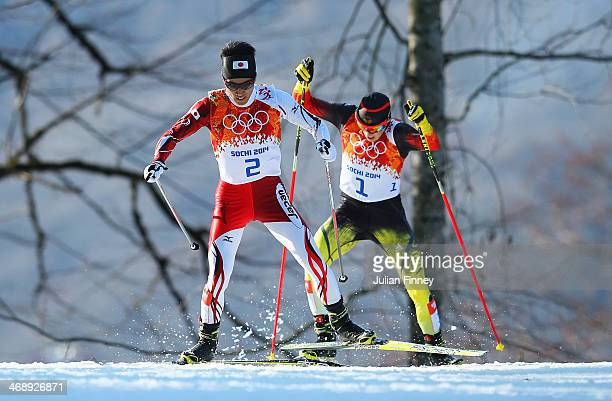 Eric Frenzel of Germany and Akito Watabe of Japan compete during the Nordic Combined Individual Gundersen Normal Hill and 10km Cross Country on day 5...