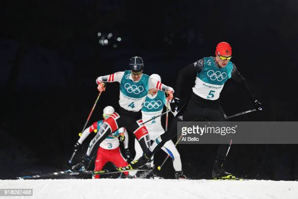 Eric Frenzel of Germany and Lukas Klapfer of Austria compete during the Nordic Combined Individual Gundersen Normal Hill and 10km Cross Country on...
