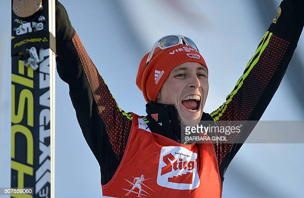 Eric Frenzel of Germany celebrates after winning the NH/10km event of the nordic combined world cup on January 30 2016 in Seefeld Austria / AFP / APA...
