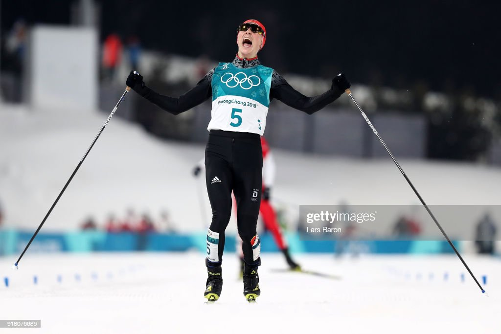 Eric Frenzel of Germany (5) celebrates as he crosses the line to win gold during the Nordic Combined Individual Gundersen Normal Hill and 10km Cross Country on day five of the PyeongChang 2018 Winter Olympics at Alpensia Cross-Country Centre on February 14, 2018 in Pyeongchang-gun, South Korea.