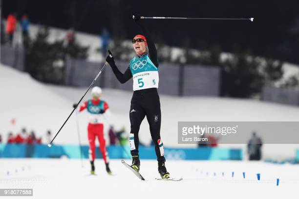 Eric Frenzel of Germany celebrates as he crosses the line to win gold during the Nordic Combined Individual Gundersen Normal Hill and 10km Cross...