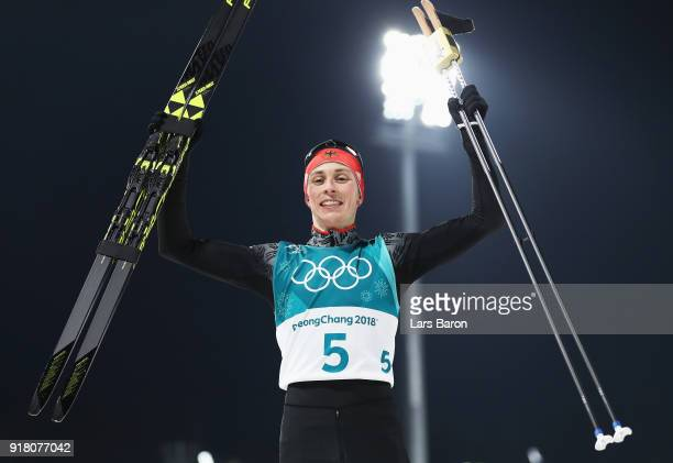 Eric Frenzel of Germany celebrates as he wins gold during the Combined Individual Gundersen Normal Hill and 10km Cross Country on day five of the...