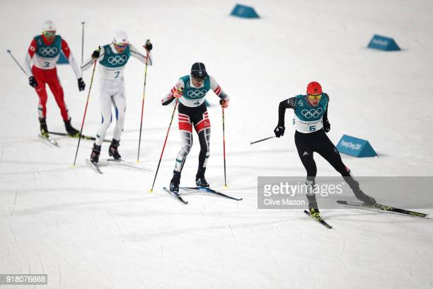 Eric Frenzel of Germany leads Lukas Klapfer of Austria during the Nordic Combined Individual Gundersen Normal Hill and 10km Cross Country on day five...