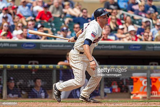 Eric Fryer of the Minnesota Twins bats against the San Diego Padres on August 6 2014 at Target Field in Minneapolis Minnesota The Padres defeated the...