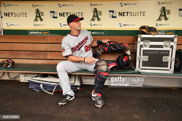 Eric Fryer of the Minnesota Twins gets ready in the dugout before the game against the Oakland Athletics at Oco Coliseum on Saturday August 9 2014 in...