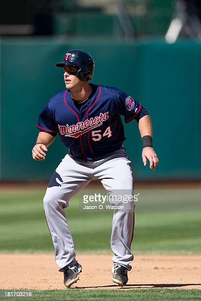 Eric Fryer of the Minnesota Twins leads off second base against the Oakland Athletics during the fourth inning at Oco Coliseum on September 22 2013...