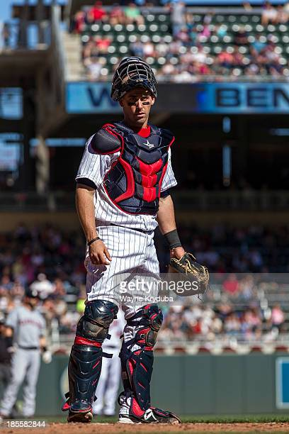 Eric Fryer of the Minnesota Twins looks in the dugout against the Cleveland Indians on September 29 2013 at Target Field in Minneapolis Minnesota The...