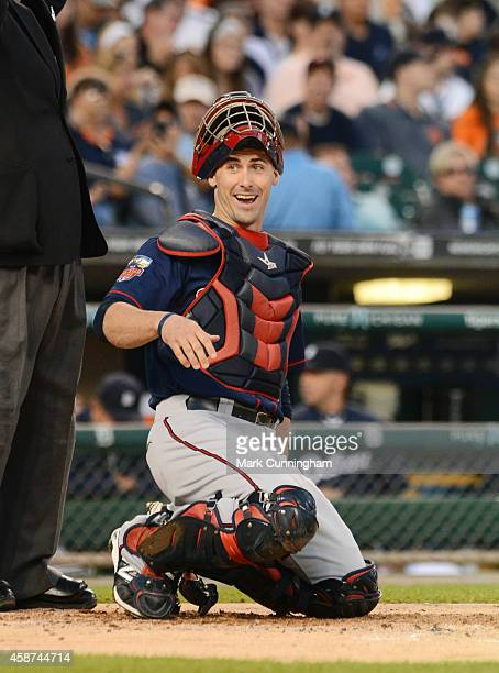 Eric Fryer of the Minnesota Twins looks on during the game against the Detroit Tigers at Comerica Park on September 27 2014 in Detroit Michigan The...