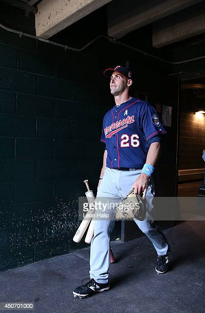 Eric Fryer of the Minnesota Twins walks fom the clubhouse to the dugout prior to the start of the game against the Detroit Tigers at Comerica Park on...