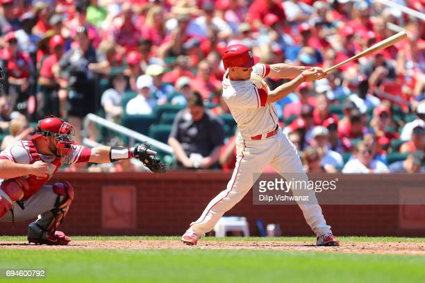 Eric Fryer of the St Louis Cardinals hits an RBI single against the Philadelphia Phillies in the fourth inning at Busch Stadium on June 10 2017 in St...
