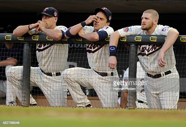 Eric Fryer, Sam Fuld and Chris Parmelee of the Minnesota Twins look on during the eighth inning of the game against the Chicago White Sox on July 26,...