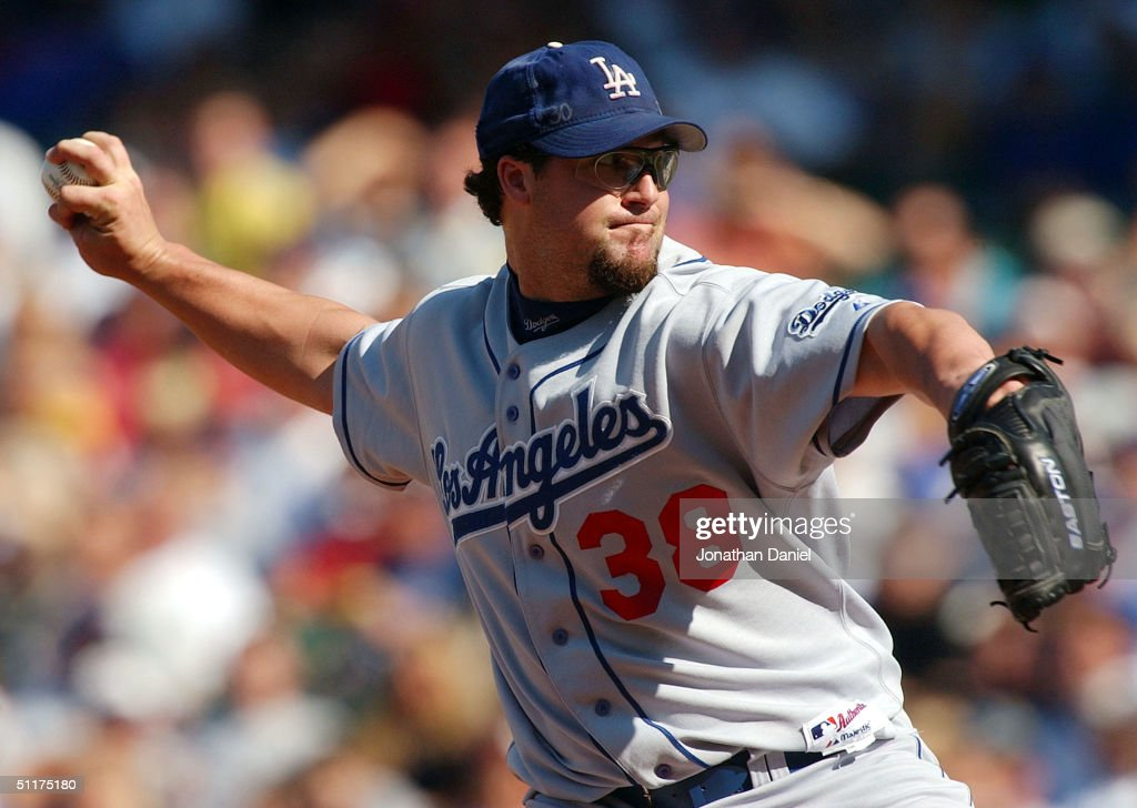 Eric Gagne #38 of the Los Angeles Dodgers delivers the ball in the eighth inning on his way to a save against the Chicago Cubs during a game on August 15, 2004 at Wrigley Field in Chicago, Illinois. The Dodgers defeated the Cubs 8-5.