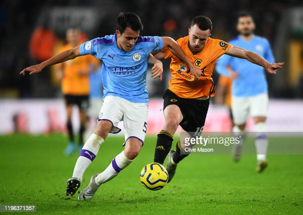 Eric Garcia of Manchester City and Diogo Jota of Wolverhampton Wanderers jostle for the ball during the Premier League match between Wolverhampton...