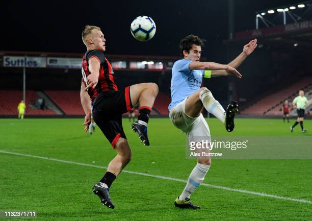 Eric Garcia of Manchester City and Jake Scrimshaw of AFC Bournemouth battle for possession in the air during the FA Youth Cup Sixth Round Match...