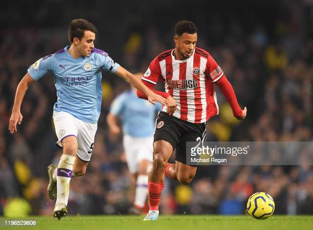 Eric Garcia of Manchester City battles for possession with Lys Mousset of Sheffield United during the Premier League match between Manchester City...