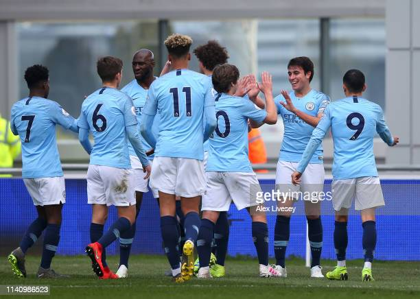 Eric Garcia of Manchester City celebrates with team mates after scoring their first goal during the Premier League 2 match between Manchester City...