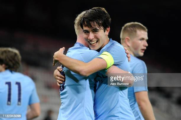 Eric Garcia of Manchester City celebrates with teammate Thomas Doyle after scoring his team's second goal during the FA Youth Cup Sixth Round Match...