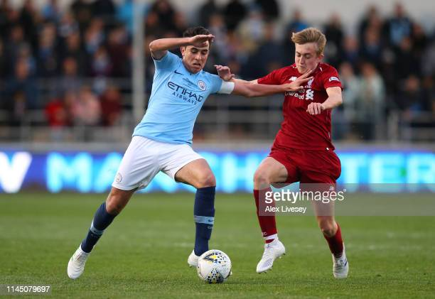 Eric Garcia of Manchester City holds off a challenge from Jake Cain of Liverpool during the FA Youth Cup Final between Manchester City and Liverpool...