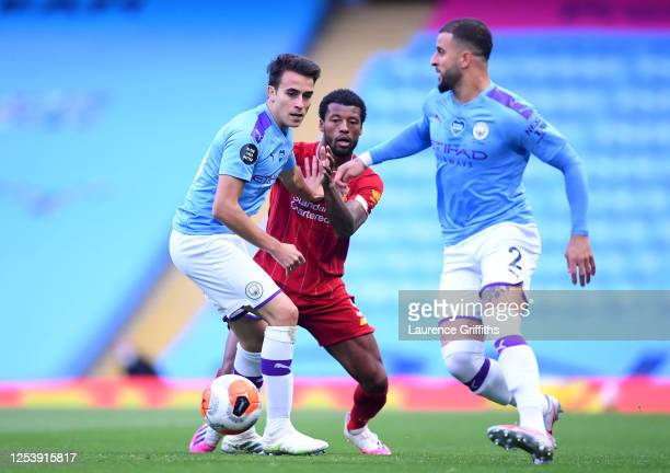Eric Garcia of Manchester City is challenged by Georginio Wijnaldum of Liverpool during the Premier League match between Manchester City and...