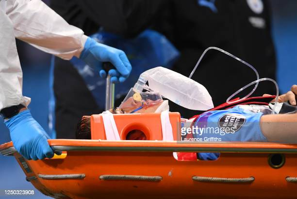 Eric Garcia of Manchester City is stretchered off after receiving medical treatment during the Premier League match between Manchester City and...