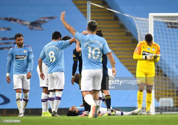 Eric Garcia of Manchester City lies on the ground after colliding with Ederson of Manchester City as players call for medial staff during the Premier...