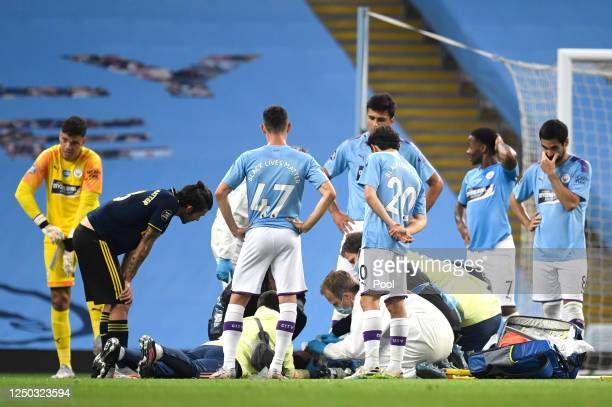 Eric Garcia of Manchester City receives medical treatment during the Premier League match between Manchester City and Arsenal FC at Etihad Stadium on...