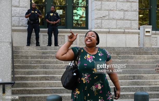 Eric Garner's daughter Emerald Snipes speaks to the press outside the Eastern District of New York July 16 after the decision by the US Attorney's...