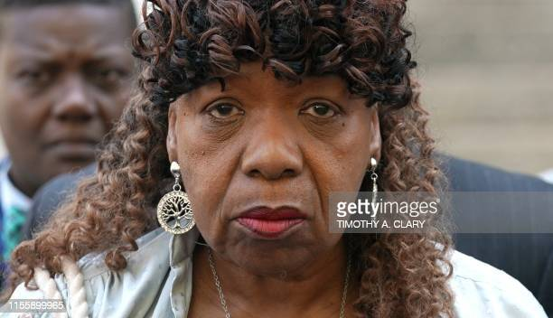 Eric Garner's mother Gwen Carr widow Esaw Snipes and family members along with National Action Network founder and President Rev Al Sharpton speak to...