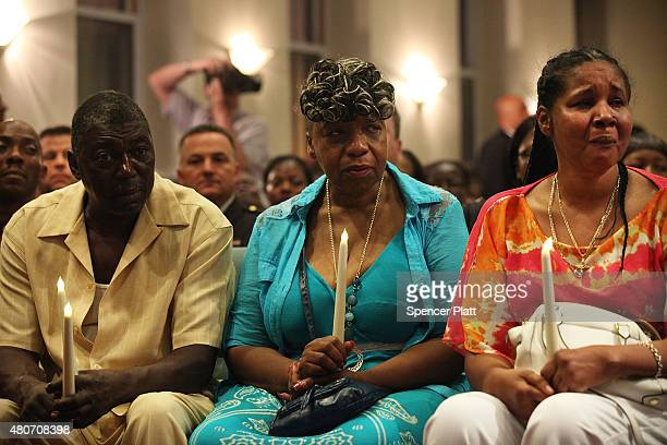 Eric Garner's stepfather, Benjamin Carr, mother Gwen Carr and his widow Esaw Garner attend an interfaith prayer service at Mount Sinai United...