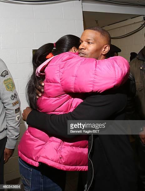 Eric Garner's widow Esaw Garner and actor Jamie Foxx attend 106 Park at BET studio on December 11 2014 in New York City