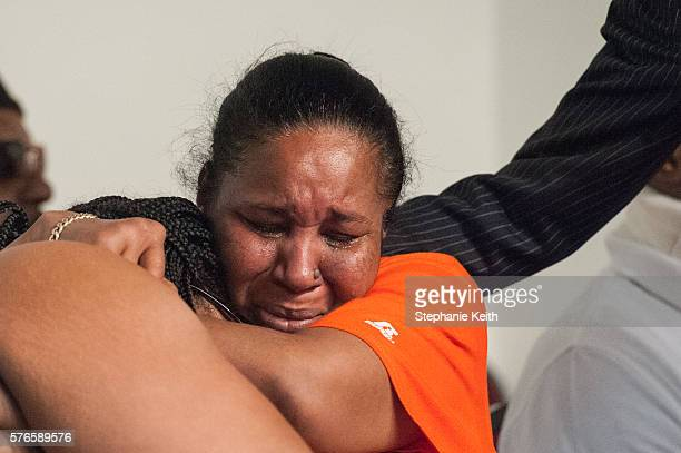 Eric Garner's widow Esaw Garner and Emerald Garner one of his children cry during a speech by Al Sharpton at the National Action Network headquarters...