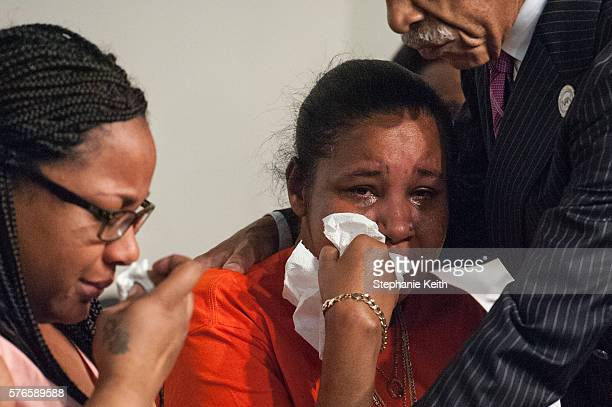 Eric Garner's widow Esaw Garner and Emerald Garner one of his children cry during an event held by Al Sharpton at the National Action Network...