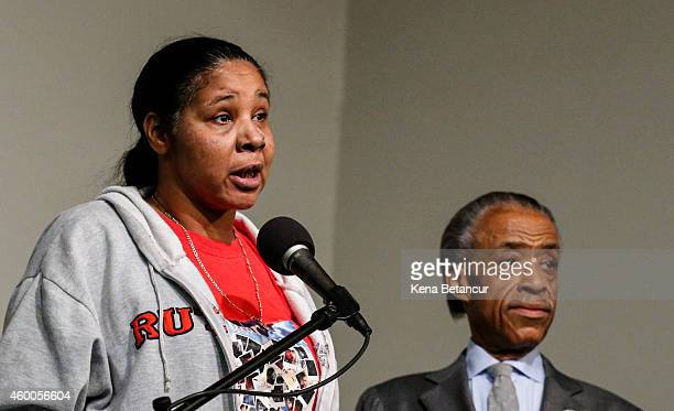 Eric Garner's widow Esaw Garner speaks at a press conference next to Rev Al Sharpton at National Action Network in Harlem on December 6 2014 in New...