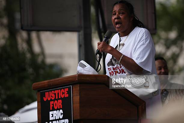 Eric Garner's widow Esaw Garner speaks at a rally in Brooklyn to call for justice for Eric Garner one year after he died in an apparent police...