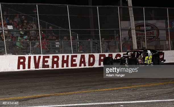 Eric Goodale driver of the GAF Roofing/RBSCorpcom races during the Hoosier Tire 200 at Riverhead Raceway on June 28 2014 in Riverhead New York
