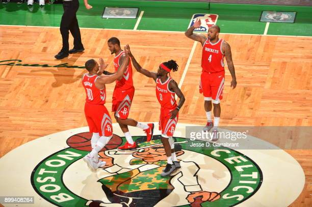 Eric Gordon and Briante Weber of the Houston Rockets give each other high fives during the game against the Boston Celtics on December 28 2017 at the...