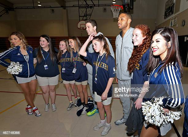Eric Gordon and Jimmer Fredette of the New Orleans Pelicans host an award ceremony for students who achieved an increase of one letter grade or...