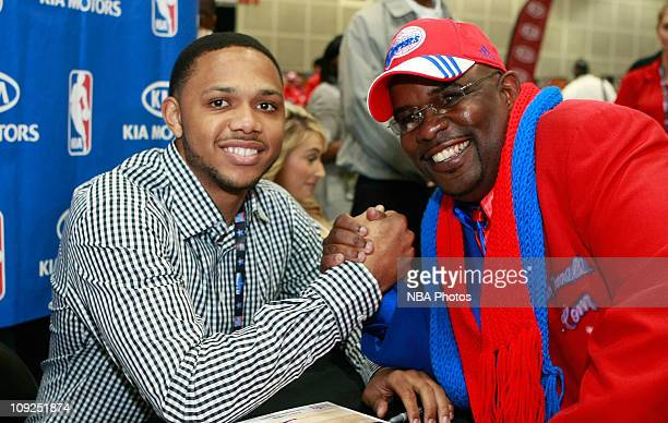 Eric Gordon of the LA Clippers signs autographs for fans at the Kia MVP Court during Jam Session presented by Adidas during NBA All Star Weekend on...