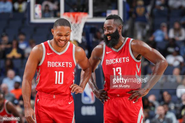 Eric Gordon of the Houston Rockets and James Harden of the Houston Rockets react during a preseason game against the Memphis Grizzlies on October 11...