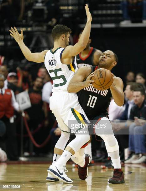 Eric Gordon of the Houston Rockets attempts to drive arounf Raul Neto of the Utah Jazz as Clint Capela looks to put up a screen during the first half...