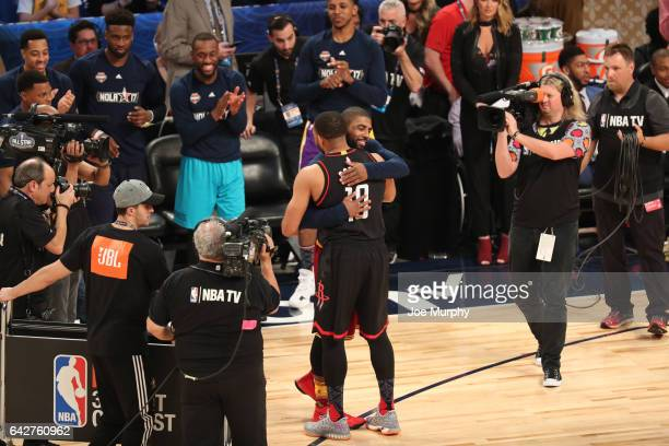 Eric Gordon of the Houston Rockets celebrates with Kyrie Irving of the Cleveland Cavaliers during the JBL ThreePoint Contest during State Farm...